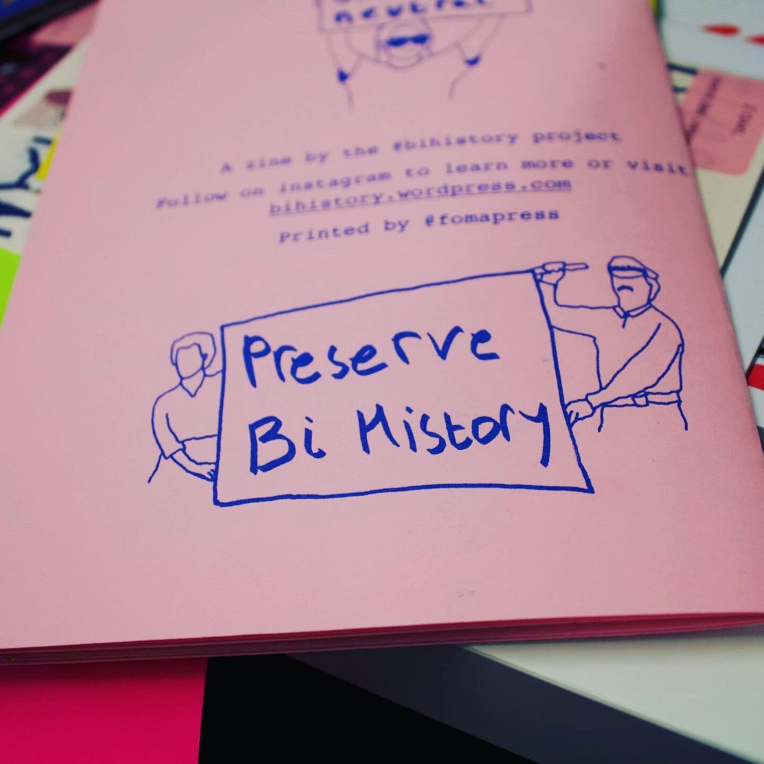 back page of a zine with illustration of people holding a flag saying 'preserve bi history'